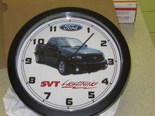 His custom clock with his custom retrofit by vanquish auto