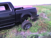wish you could see the other side it was tucked up pretty.. also this tire is on the ground still no truck rock anything  2 wheel drove it out lol Beast ford for ya!