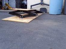 Fuel tank skid plate with dual scissor jack lift system. R.v. jacks hold lots of weight and work well with lifted trucks