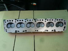 this is the best example of my cylinder head i could find. as you can clearly see that this head matches with the pic of the first block, which i don't have. by looking at these pics, i think i solved the problem with the gaskets not matching with both parts. so this head and the second block is a very close example of what i have, if not exactly.
