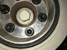 OEM bottom pulley. Accessed from under car. T50 bolts