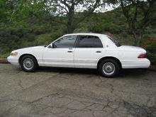 "Goodyear Alliance ComforTread Touring Tires --  215x70Rx15 -- Front -32 psi -- Rear - 35 psi  ""Italian Lace"" Wheels, Mercury Hub Caps"