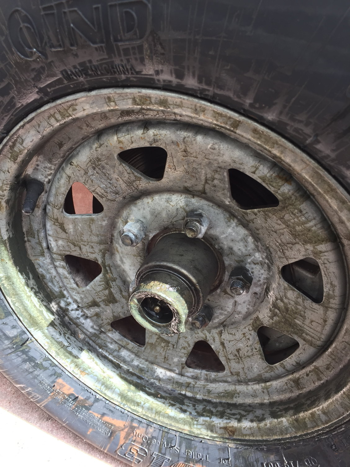 Grease all over trailer tire - The Hull Truth - Boating and