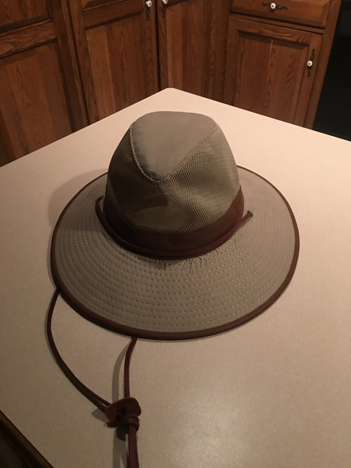 The brim is stiff and doesn t flop running at 30 knots. The vents mesh on  top are not perfect for sun protection. But the stiff brim makes up for it. b99a7de201bb