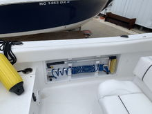 Port side carries a telescoping boat hook, Shurhold Deck Brush and raw water wash down hose & nozzle