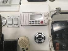 VHF, trim tabs, & stereo controls.