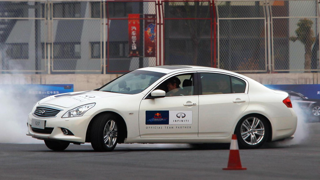 Sebastian Vettel at a track with the Infiniti G37 and FX50