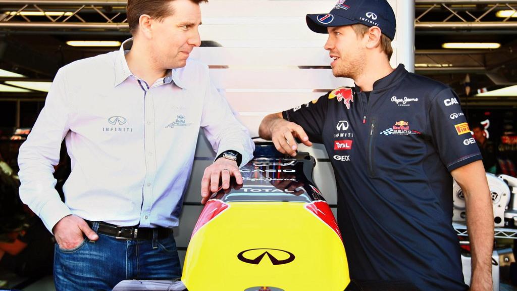 Infiniti's Simon Sproule and Sebastian Vettel