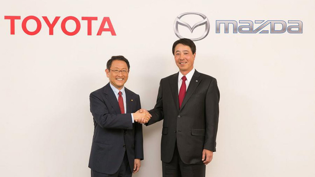 Toyota chief Akio Toyoda (left) and Mazda chief Masamichi Kogai