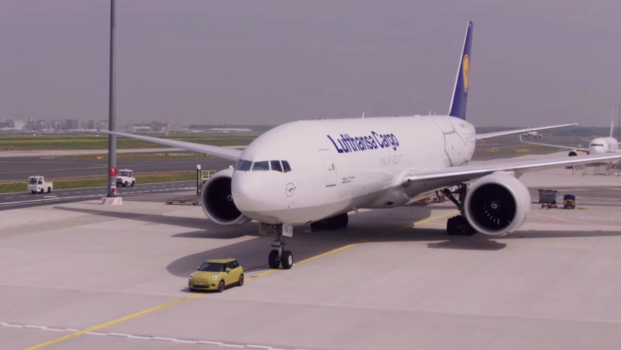 Mini Cooper S E pulls Boeing cargo plane