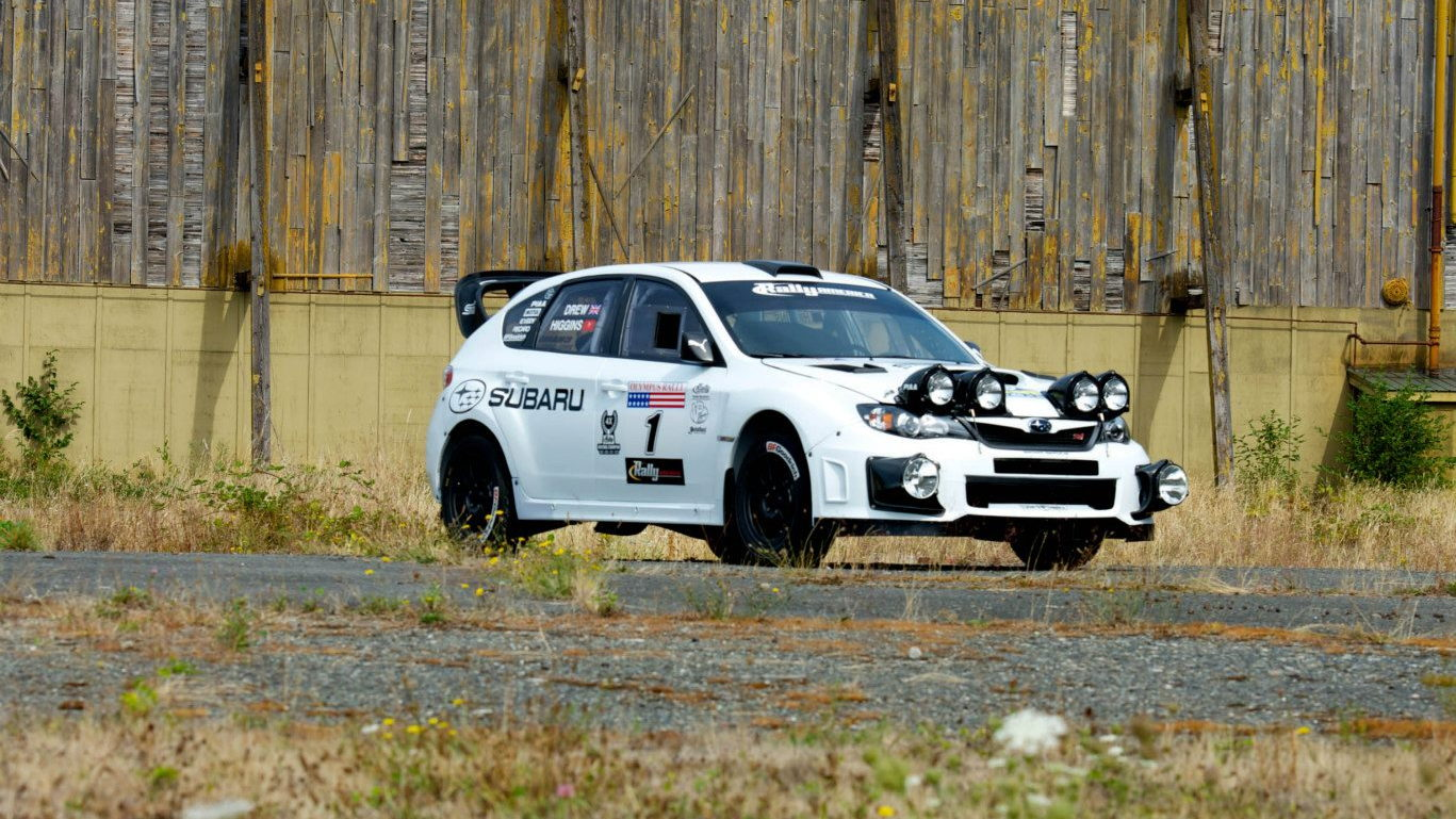 Subaru Rally Team USA WRX STI rally car in white livery. Images via SRT USA.