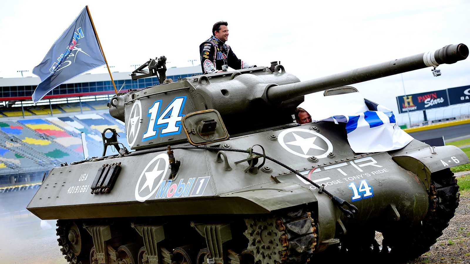 Tony Stewart swaps his ride for the day - image credit Grant Halverson / Getty Images for Mobil 1