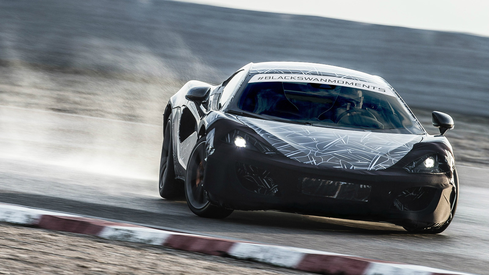 Teaser for McLaren 570S Coupe debuting at 2015 New York Auto Show