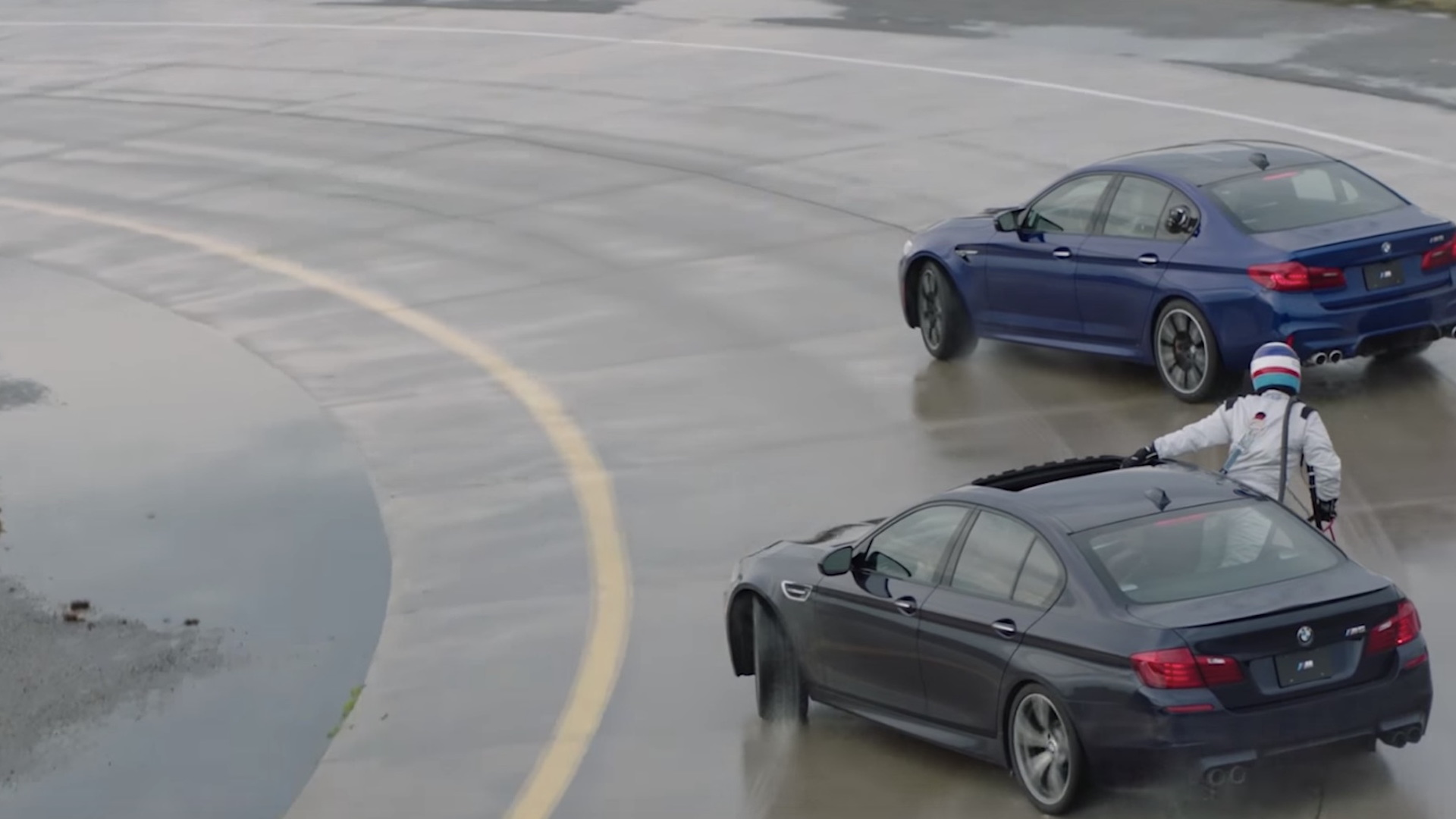 BMW car-to-car refueling during longest vehicle drift world record attempt