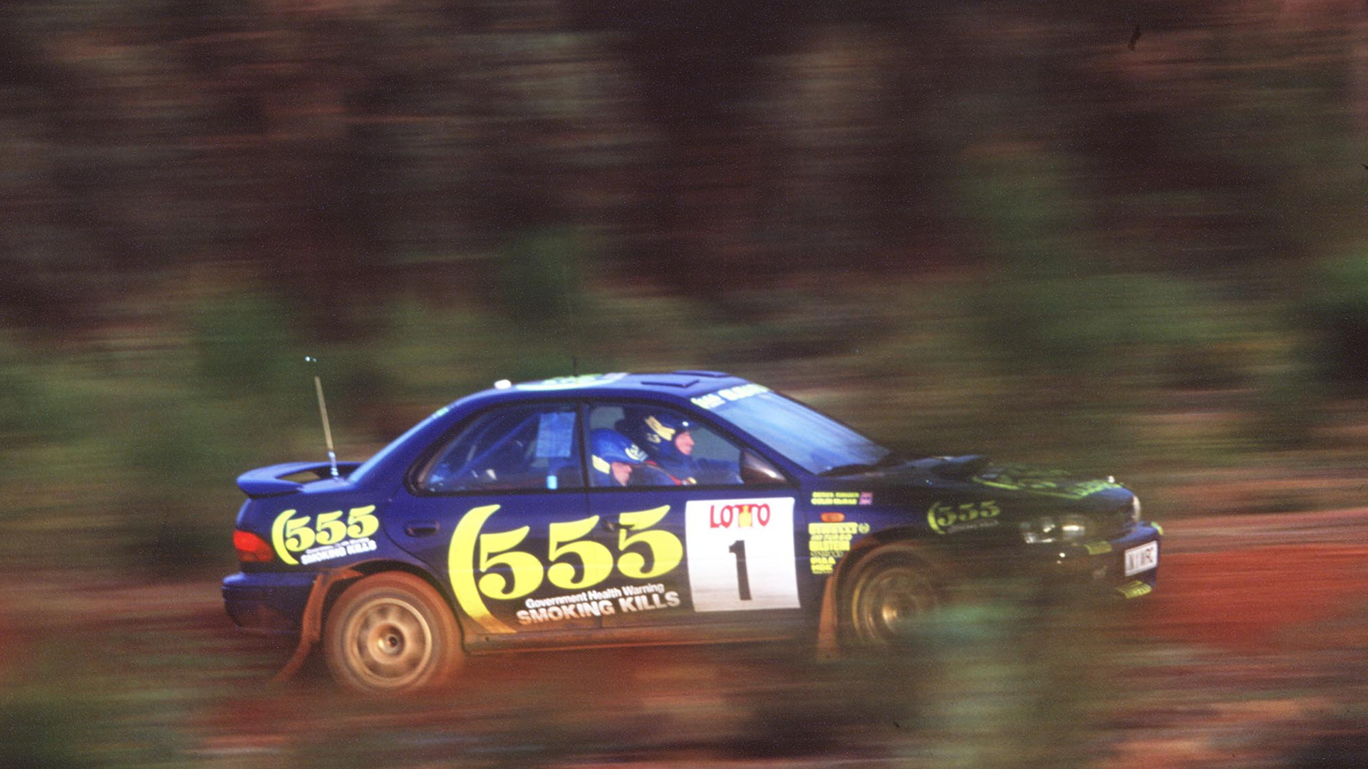 Colin McRae drives a Subaru Impreza Group A rally car build by Prodrive