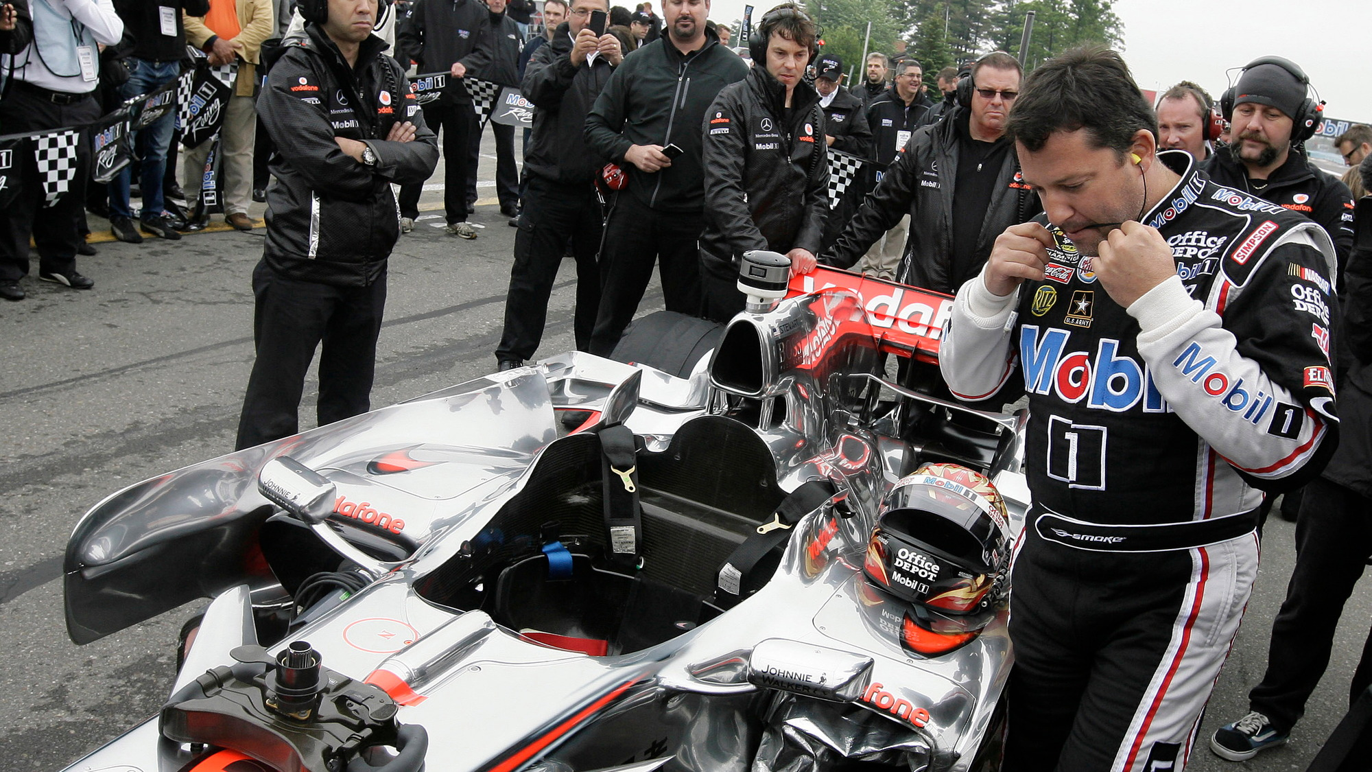 Tony Stewart and Lewis Hamilton swap cars at Watkins Glen, 2011