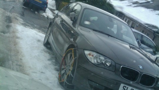 BMW 1-Series with snow chains on front wheels, Staffordshire, England, Dec 2010, photo by Andy Smith