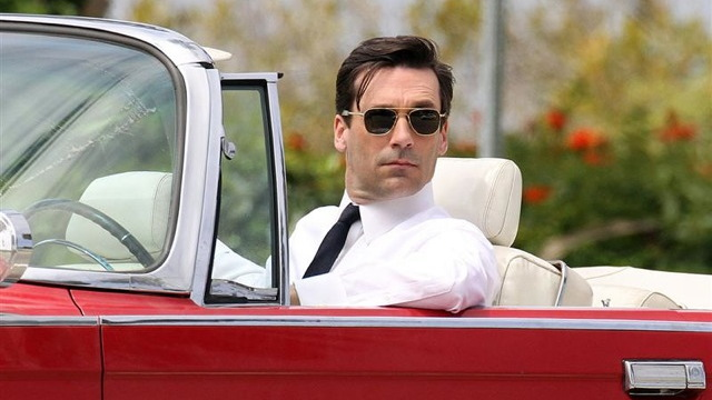 Actor Jon Hamm in a 1964 Chrysler Imperial Convertible during the filming of Mad Men