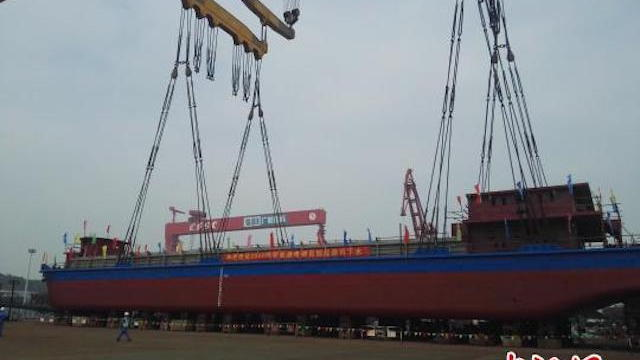 China's all-electric cargo ship will deliver coal to powerplants. China News/Peng Yonggui