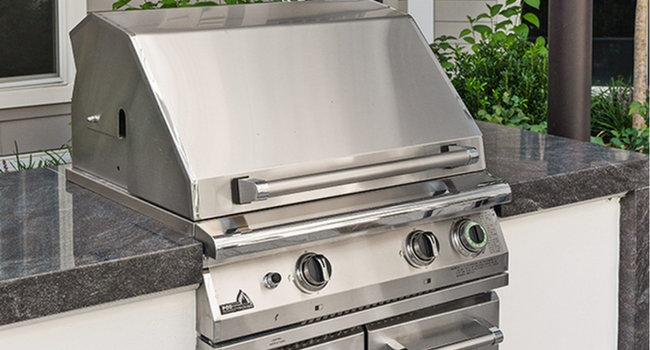 Outdoor kitchen with grilling stations