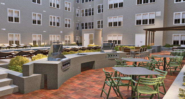 Poolside outdoor courtyard featuring barbeque and dining areas
