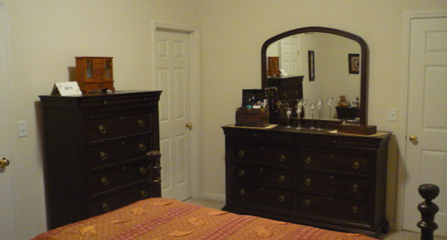 The other items in the bedroom suit, the door to the attached bathroom.